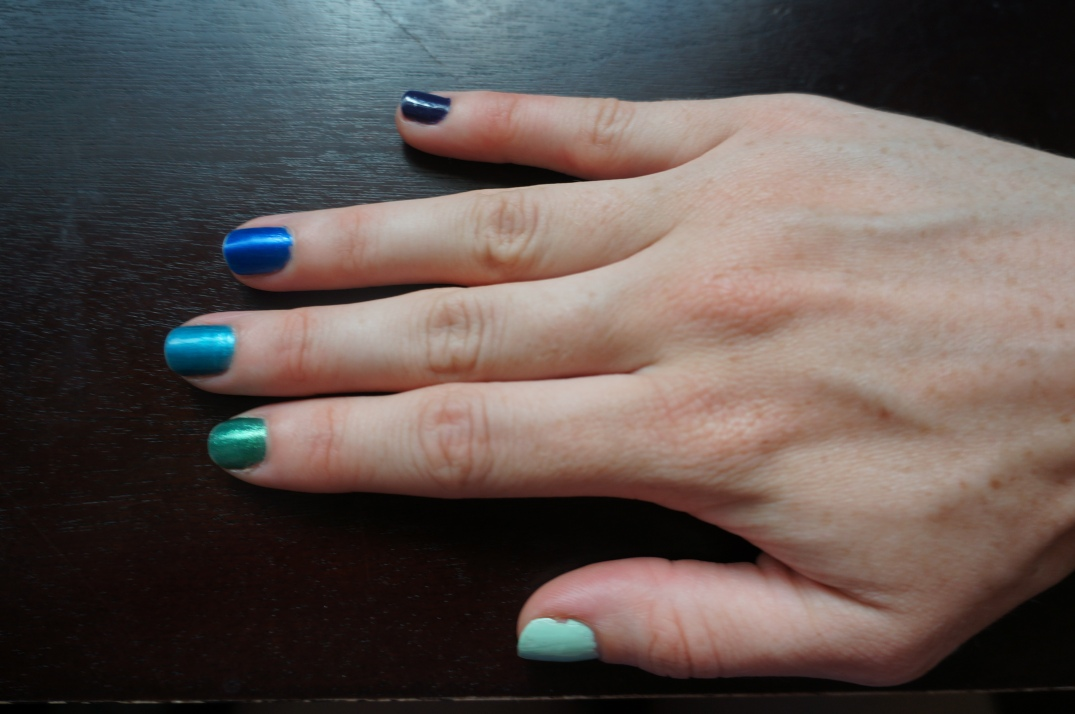 Mint green, emerald green, turquoise, royal blue, and purple from thumb to pinkie.