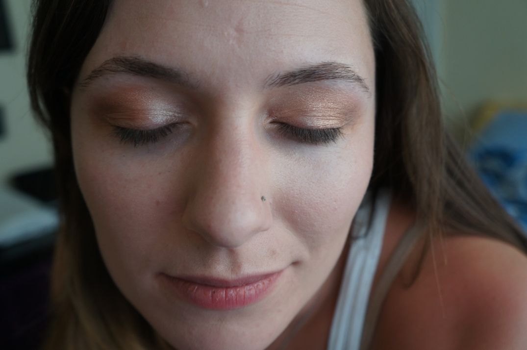 With two shades of eyeshadow - peach on the inner half, and copper in the crease and outer v.