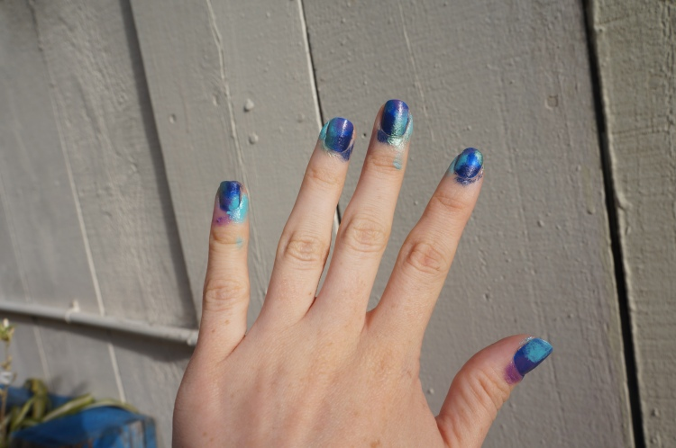 After stamping on aqua, green, purple, and navy blue polish